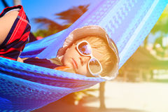 Happy little boy relaxed in hammock on the beach Royalty Free Stock Image