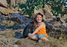Happy little boy resting after hiking expedition Royalty Free Stock Image