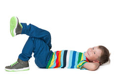 Happy little boy rests. A happy little boy rests on the white background stock images