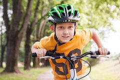 Happy little boy ride a bicycle Royalty Free Stock Image