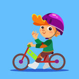 Happy little boy riding balance bike. Stock Photos