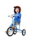Happy little boy riding bicycle on white background. Royalty Free Stock Photo