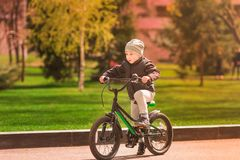 Happy little boy riding a bike Royalty Free Stock Images