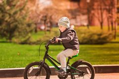Happy little boy riding a bike Royalty Free Stock Photos