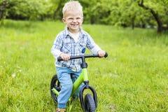 Happy little boy riding learner bike Royalty Free Stock Photo