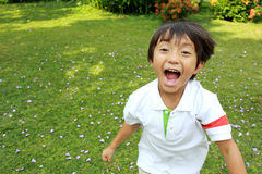 Happy little boy running Royalty Free Stock Photography