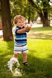Happy little boy running stock photography