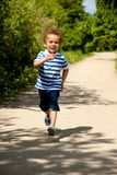 Happy Little Boy Running Stock Photo