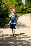 Happy Little Boy Running Stock Photo