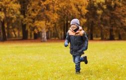 Happy little boy running on autumn park field Stock Image