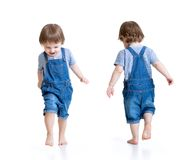 Happy little boy running. Front and rear view Stock Image