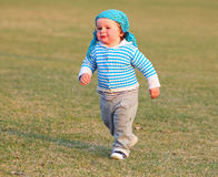 Happy little boy running in garden Stock Photography