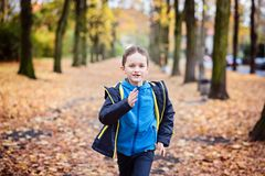 Happy little boy running Royalty Free Stock Images