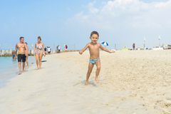 Happy little boy running on sand tropical beach. Positive human emotions, feelings, joy. Funny cute child making vacations and enj Royalty Free Stock Image