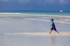 Happy little boy running on summer beach Royalty Free Stock Photos