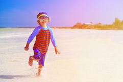 Happy little boy running on tropical beach Royalty Free Stock Photo