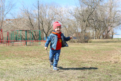 Happy little boy runs outdoors in springtime Royalty Free Stock Photography