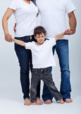 Happy little boy in the safety of his family Stock Photography