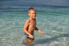 Happy little boy in sea Stock Photos