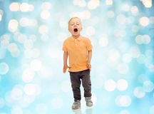 Happy little boy shouting or sneezing Royalty Free Stock Photos