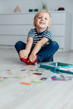Happy little boy sitting on the floor Royalty Free Stock Photography