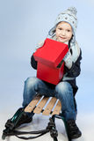 Happy Little Boy Sitting On A Sled At Winter Time Royalty Free Stock Photography