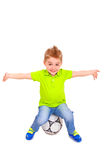 Happy little boy sitting on a soccer ball Royalty Free Stock Photography