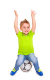 Happy little boy sitting on  soccer ball Royalty Free Stock Photos