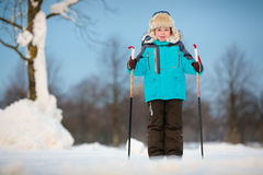 Happy little boy skiing on cross Royalty Free Stock Images