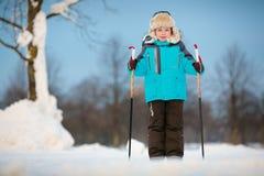Happy little boy skiing on cross Stock Images