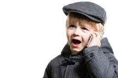Happy little boy speaking on mobile over white background Royalty Free Stock Image