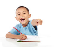 Happy little boy studying Stock Images