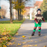 Happy little boy in sunny day on rolle Royalty Free Stock Images