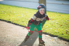 Happy little boy in sunny day on rolle Stock Images