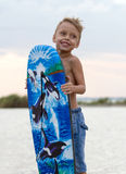 Happy little boy with surfing board Stock Image