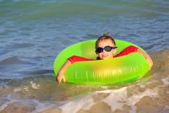 Happy little boy swim at summer beach Stock Images