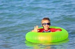 Happy little boy swim at summer beach Stock Photos