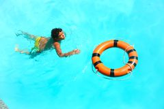 Boy swimming at pool with mask. Happy little boy swimming at pool with diving mask royalty free stock photos
