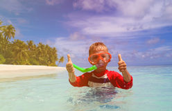 Happy little boy swimming with thumbs up at beach Royalty Free Stock Photography