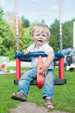 Swinging little boy Royalty Free Stock Photo