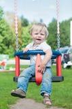 Swinging little boy Royalty Free Stock Photo