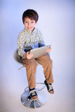 Happy little boy with a tablet pc Stock Photo