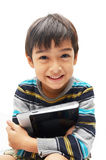Happy little boy with tablet Royalty Free Stock Photo