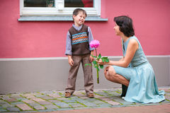 Happy little boy talking with his mother outdoors Royalty Free Stock Photography