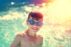Happy little boy teeth smile in swimming pool Royalty Free Stock Image