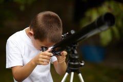 Happy little boy with telescope Stock Photos