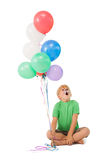 Happy little boy in tiger face paint with balloons Stock Images