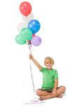 Happy little boy in tiger face paint with balloons Royalty Free Stock Photography