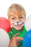 Happy little boy in tiger face paint with balloons. On white background royalty free stock photos