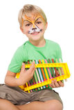 Happy little boy in tiger face paint playing xylophone Royalty Free Stock Photos